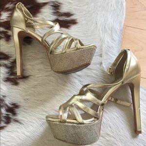 Jessica Simpson gold platform high heels